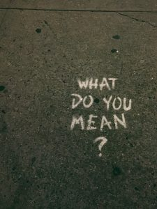 """Road with """"what do you mean"""" written on it to reinforce the need to speak carefully to children about addiction and substance abuse and recovery"""