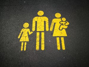 A road painted with a family in yellow meant to symbolize spending time together, even and especially when someone is in recovery from substance abuse.
