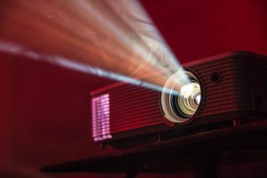 a projector used to reinforce the function of the defense mechanism of projecting onto a family member when a person abusing substances doesn't want to be confronted