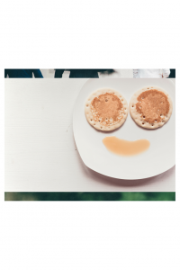 a smile made out of pancakes and syrup to reinforce the need to laugh as a family after substance abuse treatment