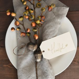 """a simple decorated place setting with """"thanks"""" on it to reinforce the idea of gratitude as a tool in substance abuse recovery"""