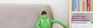 kermit the frog on a couch laughing to reinforce the idea that laughter is a powerful recovery tool in substance abuse recovery