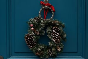 a holiday wreath on a door to symbolize the need to be intentional about a sober holiday season
