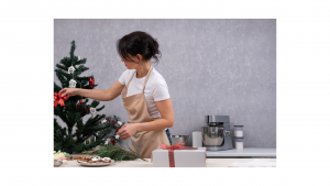 a mom in a kitchen during the holidays to reinforce the need to be intentional about planning celebrations for a healthy sober holiday season