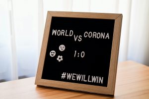 """a sign that says """"the world vs. corona"""" #we will win to encourage readers that we will get through this"""