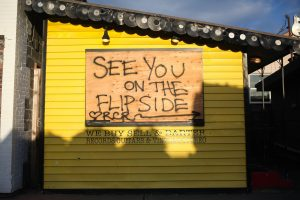 """a structure with graffitti that says """"see you on the flipside"""" to remind readers of how we are all wanting to get past the hard times of 2020 and the pandemic and that stress is a burden to sobriety"""