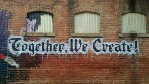 together we create written on a wall to symbolize a family working together after substance abuse treatment